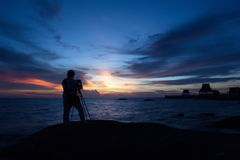 Cameraman. Cameramen are shooting the sun goes down Stock Images