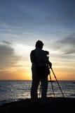 Cameraman3. Cameramen waiting time is sunset on the horizon Royalty Free Stock Photography