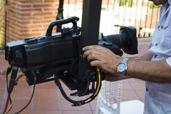 Cameraman checking equipment of camera in broadcast television royalty free stock photos