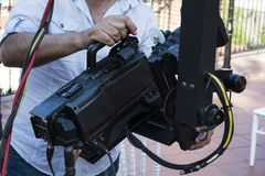 Cameraman checking equipment of camera in broadcast television royalty free stock image