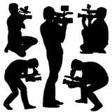 Cameraman con la cámara de vídeo. Siluetas en blanco Foto de archivo