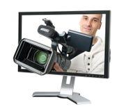 Cameraman dans un moniteur d'ordinateur images stock