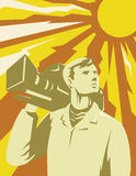 Cameraman Film Crew With Video Camera. Illustration of a cameraman film crew looking up with video camera on shoulder with sun in the background done in retro Stock Photo
