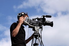 Cameraman filming. Photograph of a cameraman filming at an airshow in Shropshire, England Royalty Free Stock Photos