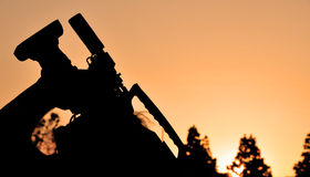 Cameraman Filming at Dusk. Silhouette of video cameraman filming in evening with setting sun Royalty Free Stock Images