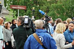 The cameraman filming outdoor event. ARD  reporter Stock Image