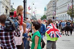 The cameraman filming outdoor event. TVN  reporter. Warsaw,Poland.17 July 2017. Visit of the royal couple in Warsaw.The cameraman filming outdoor event. TVN Royalty Free Stock Photos