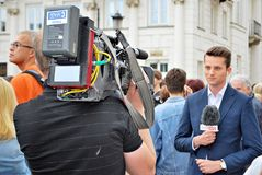 The cameraman filming outdoor event. TVP  reporter Stock Images