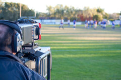 Cameraman filming sport. A TV camera operator filming rugby Stock Images