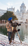 Cameraman at Golden Temple in the early morning. Amritsar. India Royalty Free Stock Photo