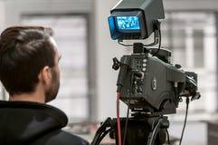 Cameraman het werken Royalty-vrije Stock Afbeeldingen