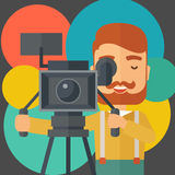 Cameraman and his video cam with stand Stock Photos