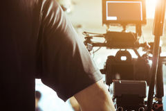 Cameraman. With his video camera shooting, Adjusting Camera,film production cre. behind the scenes background stock images
