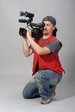 Cameraman i röd vest Arkivbild