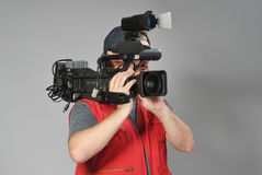 Cameraman i röd vest Arkivbilder