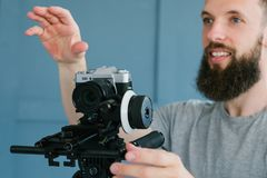 Cameraman instruction creative footage shooting. Cameraman instructions. creative vision of video making. work in process. man holding camera and directing royalty free stock image
