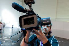 Cameraman live broadcasting Stock Photos