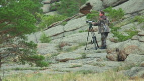 Cameraman in mountains stock video