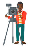 Cameraman with movie camera. An african-american cameraman looking through movie camera on a tripod vector flat design illustration isolated on white background vector illustration