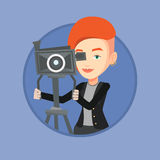 Cameraman with movie camera on tripod. Royalty Free Stock Photo