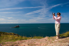 Cameraman in nature taking pictures, video Stock Image