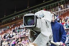 Cameraman opposite the racecourse grandstand Stock Photo