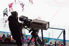 Cameraman point on tribune Royalty Free Stock Photos