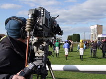 Cameraman At Races Photographie stock libre de droits