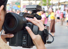 Cameraman recording video Stock Photo