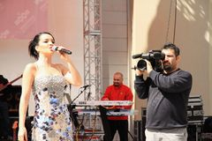 Cameraman records concert Stock Photo