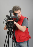 Cameraman in red vest Stock Images