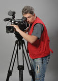 Cameraman in red vest Stock Photo