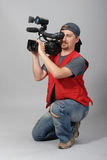 Cameraman in red vest Royalty Free Stock Photos