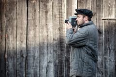 Cameraman with retro film camera. Concept - cinema industry, movie of 1970s. Cameraman with retro film camera. Idea - cinema industry, movie of 1970s royalty free stock photography