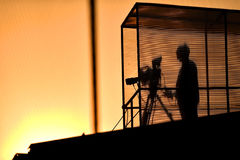 Cameraman`s silhouette broadcasting Royalty Free Stock Image
