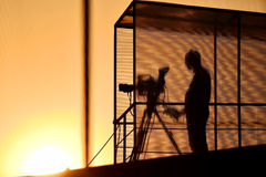 Cameraman`s silhouette broadcasting Royalty Free Stock Photo