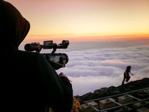 Cameraman shooting. Cameraman filming, sequence during sunset on the island of El Hierro, Canary Islands, Spain Stock Image