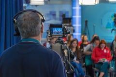 Cameraman shooting in studio Royalty Free Stock Images