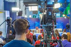 Cameraman shooting in studio Stock Images