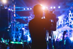 Cameraman shooting video production camera videographer. In concert music festival royalty free stock images