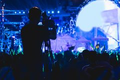 Cameraman shooting video production camera videographer. In concert music festival royalty free stock photo