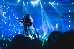 Cameraman shooting video production camera videographer. In concert music festival stock photo