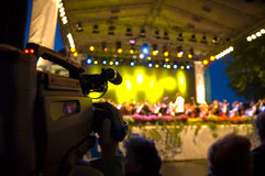 Cameraman shoots the concert. Shooting concert of classic music out-of-door stock image