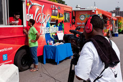 Cameraman Shoots Reporter Interviewing Food Truck Employee Stock Photography