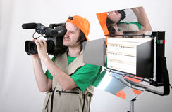 Cameraman shot with light. Cameraman work with dvcam camcroder and use professional light equipment Royalty Free Stock Images