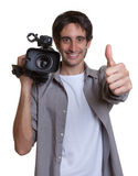 Cameraman showing thumb up. On an isolated white background for cut out Royalty Free Stock Photo