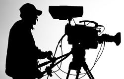 Cameraman silhouette. A cameraman silhouette isolated on white background Stock Photography