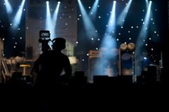 Cameraman silhouette. On a concert stage Royalty Free Stock Photo
