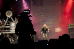 Cameraman silhouette. On a concert stage stock photography
