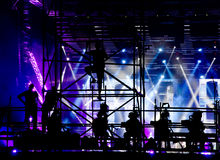 Cameraman silhouette. On a concert stage royalty free stock photography